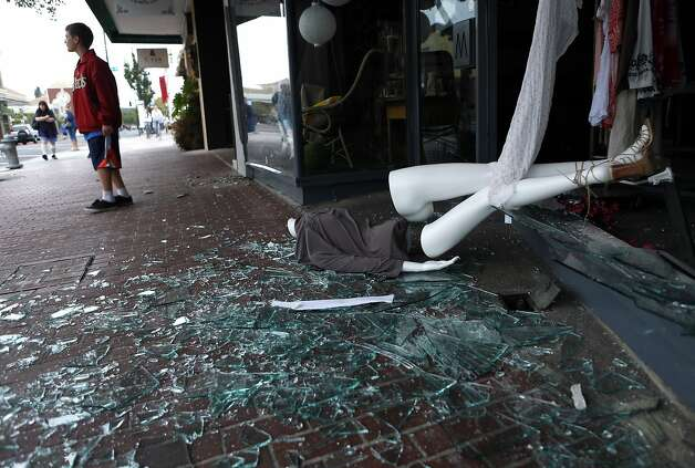A mannequin lays outside the shattered front window of Boho, a store on 1st Street, after an earthquake in Napa, Calif. on Sunday, August 24, 2014, Photo: Scott Strazzante, The Chronicle