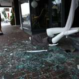 A mannequin lays outside the shattered front window of Boho, a store on 1st Street, after an earthquake in Napa, Calif. on Sunday, August 24, 2014,