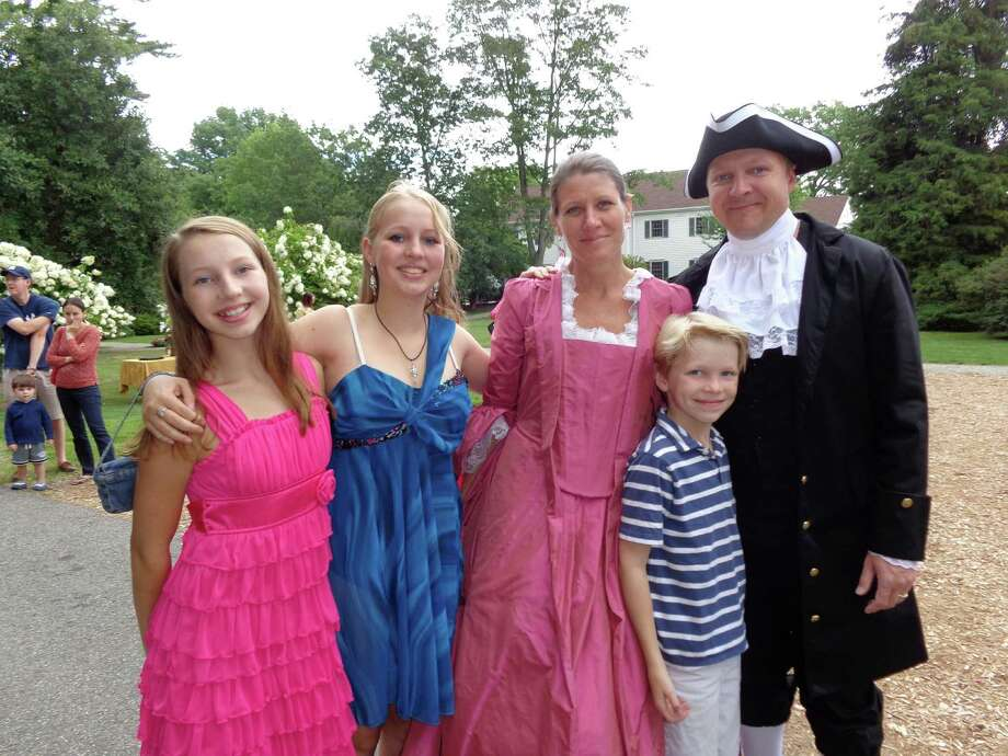 The Littig family, from left, Lauren, 12; Emma, 14; mom Jill -- as Dorothy Quincy -- Trescher, 8 and dad Rip -- as John Hancock at Saturday's re-enactment of the Hancock-Quincy nuptials. Photo: Meg Barone / Fairfield Citizen