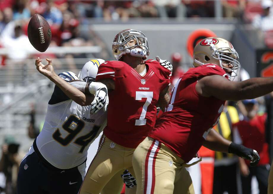 The 49ers' Colin Kaepernick fumbles as he is hit by the Chargers' Corey Liuget in the first quarter. Photo: Michael Macor, The Chronicle