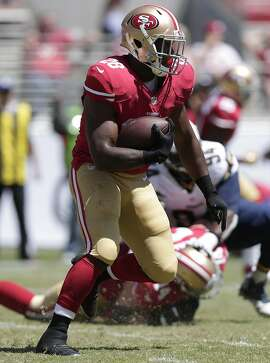 San Francisco 49ers running back Carlos Hyde (28) runs against the San Diego Chargers during the first quarter of an NFL preseason football game in Santa Clara, Calif., Sunday, Aug. 24, 2014. (AP Photo/Marcio Jose Sanchez)