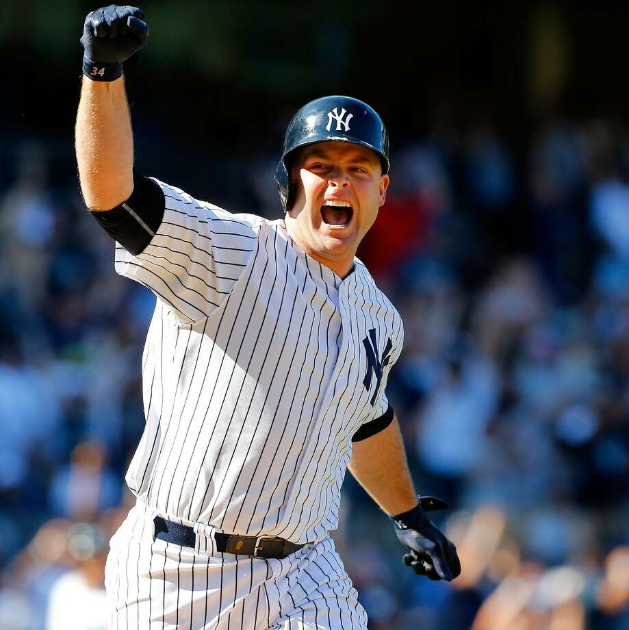 The Yankees' Brian McCann celebrates as he circles the bases after hitting a game-ending, three-run homer against the White Sox. Photo: Jim McIsaac, Getty Images