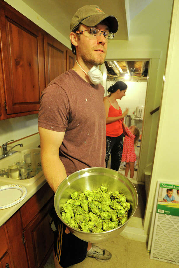 Ryan Ricklic shows off the hops his family grew in their back yard garden for the beer they make at the Ricklic home in Stamford, Conn., on Sunday, Aug. 24, 2014. Photo: Jason Rearick / Stamford Advocate