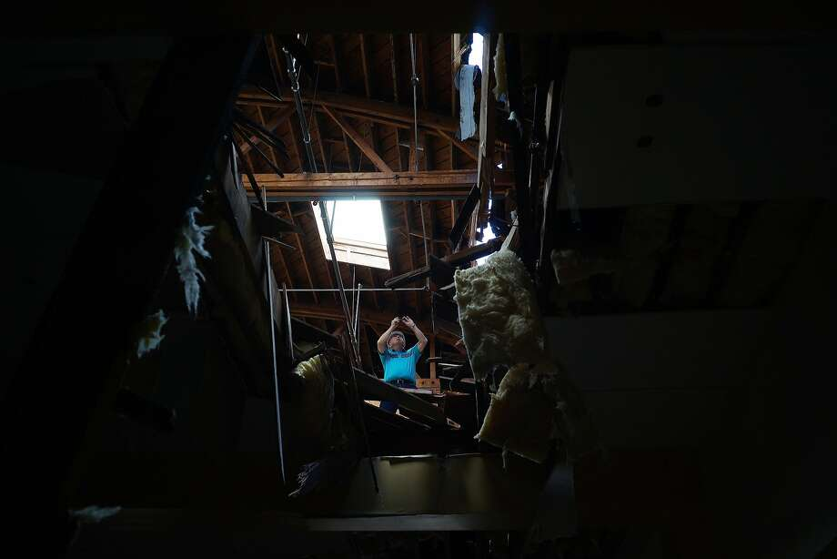 A man takes a photo of a collapsed roof on Georgia St. on Sunday, August 24, 2014 in Vallejo, Calif.  A 6.0 earthquake rattled much of the Bay Area early Sunday morning. Photo: James Tensuan, Special To The Chronicle