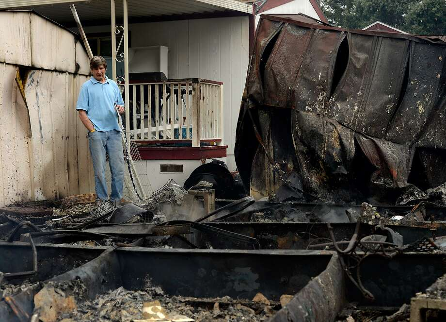 Napa Valley Mobile Home Park resident Frank Jones sprays water on a hot spot where his neighbor's home burned to the ground after a magnitude 6.0 earthquake struck in the early morning of August 24, 2014, in Napa, California. Photo: Alvin Jornada, Special To The Chronicle