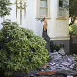 Debris from a damaged chimney are seen on Walnut Ave. on Sunday, August 24, 2014 in Vallejo, Calif.  A 6.0 earthquake rattled much of the Bay Area early Sunday morning.