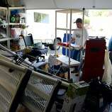 Keith Farace, left, helps his father Joe Farace, clean up fallen shelving units inside Joe's garage, after a magnitude 6.0 earthquake struck in the early morning of August 24, 2014, in Napa, California.