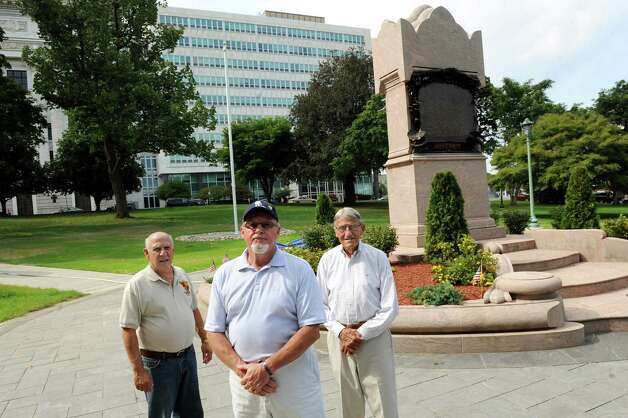 Joe Pollicino, left, Kevin Hicks, center, and Charlie Johnson pose with the Albany County Vietnam Veterans Monument on Wednesday, Aug. 20, 2014, at Lafayette Park in Albany, N.Y. (Cindy Schultz / Times Union) Photo: Cindy Schultz / 00028263A