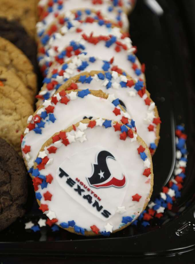 A decorated Houston Texans cookie is served during a lunch honoring HFD's Senior Captain Brad Hawthorne and Engineer Operator Dwayne Wyble at Station 18. Photo: Karen Warren, Houston Chronicle