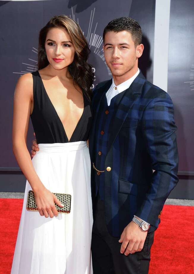 Olivia Culpo, left, and Nick Jonas arrive at the MTV Video Music Awards at The Forum on Sunday, Aug. 24, 2014, in Inglewood, Calif. Photo: Jordan Strauss, AP / Invision