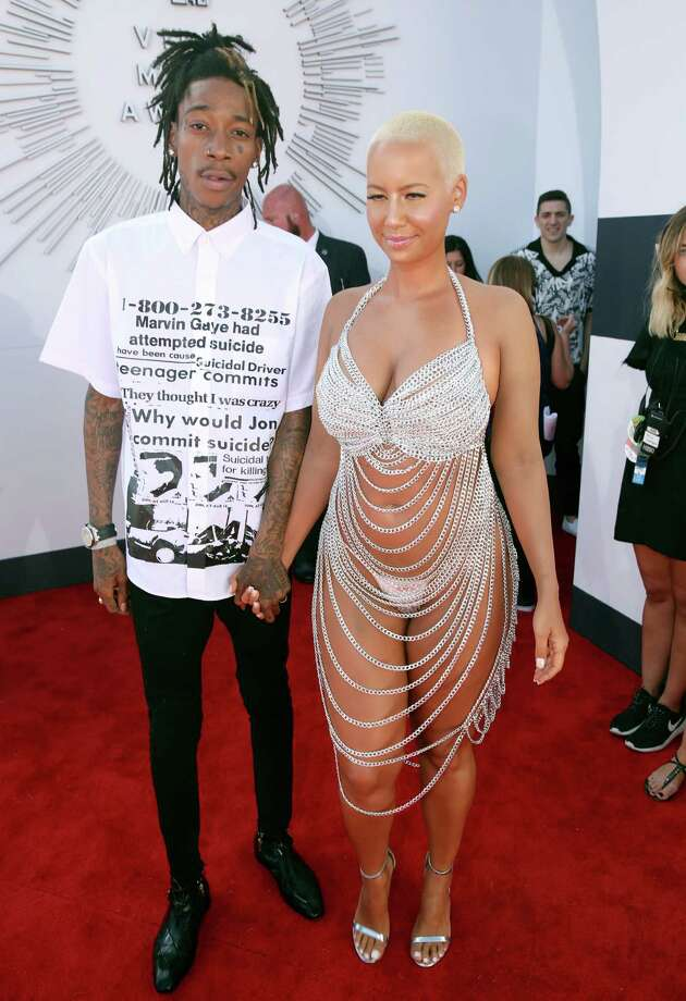 Wiz Khalifa, left, and Amber Rose arrive at the MTV Video Music Awards at The Forum on Sunday, Aug. 24, 2014, in Inglewood, Calif. Photo: Matt Sayles, AP / Invision