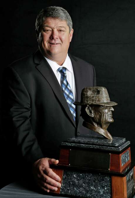 "Rice coach David Bailiff, finalist for the Paul ""Bear"" Bryant college coach of the year award, poses with the trophy Wednesday, Jan. 15, 2014, in Houston. (AP Photo/Pat Sullivan) Photo: Pat Sullivan, STF / AP"