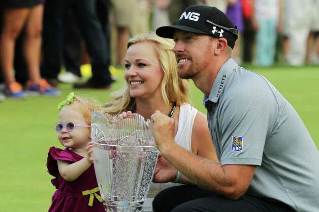 PARAMUS, NJ - AUGUST 24:  Hunter Mahan celebrates with his wife Kandi, daughter Zoe and the tournament trophy after winning of The Barclays at The Ridgewood Country Club on August 24, 2014 in Paramus, New Jersey.  (Photo by Hunter Martin/Getty Images) ORG XMIT: 462145639 Photo: Hunter Martin / 2014 Getty Images