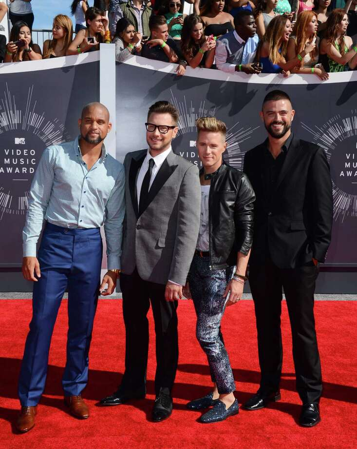 "Shaun T and from left Rob Younkers, Theodore Leaf, John Gidding from ""The Secret Guide to Fabulous"" arrives at the MTV Video Music Awards at The Forum on Sunday, Aug. 24, 2014, in Inglewood, Calif. Photo: Jordan Strauss, AP / Invision"