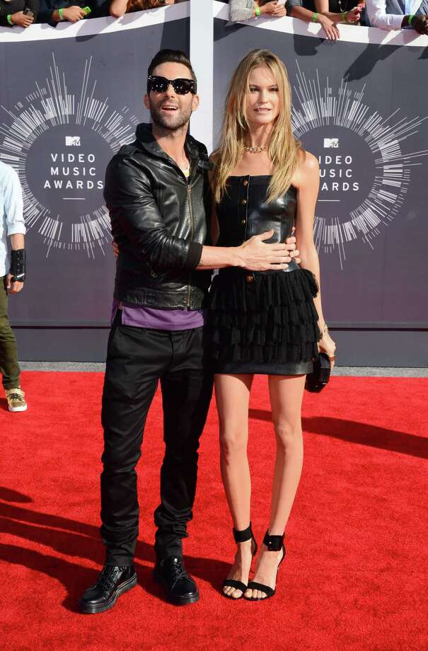 Adam Levine, left, and Behati Prinsloo arrive at the MTV Video Music Awards at The Forum on Sunday, Aug. 24, 2014, in Inglewood, Calif. Photo: Jordan Strauss, AP / Invision