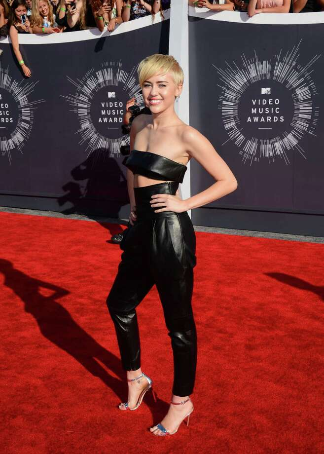 Miley Cyrus arrives at the MTV Video Music Awards at The Forum on Sunday, Aug. 24, 2014, in Inglewood, Calif. Photo: Jordan Strauss, AP / Invision