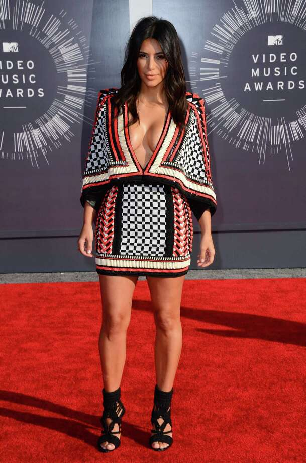 WorstIf Kim K is going out in a low-cut poncho, she may want to have her arms free to fix the neckline should a blustery wind sweep down the red carpet.  Photo: Jordan Strauss, AP / Invision