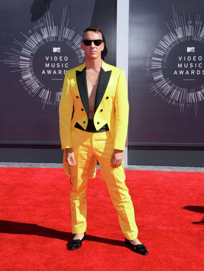 WorstFrom the sock- and shirt-based evidence, we assume Jeremy Scott is not wearing any underpants with is loud yellow suit.  Photo: Jordan Strauss, AP / Invision