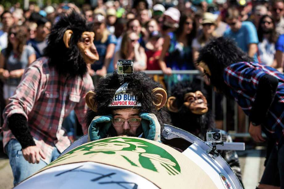 The driver of the Single Shot Simians adjusts his glasses before bombing down the steep grade of Yesler Way - with jumps and hard turns included - at the Red Bull Soapbox Race Sunday, August 24, 2014, in downtown Seattle, Washington. The rickety vehicles reached speeds of 40 miles per hour, sometimes plowing into the straw walls of the raceway. The first Red Bull Soapbox Race took place in Belgium in 2000, and has since visited almost 30 countries. Photo: JORDAN STEAD, SEATTLEPI.COM / SEATTLEPI.COM