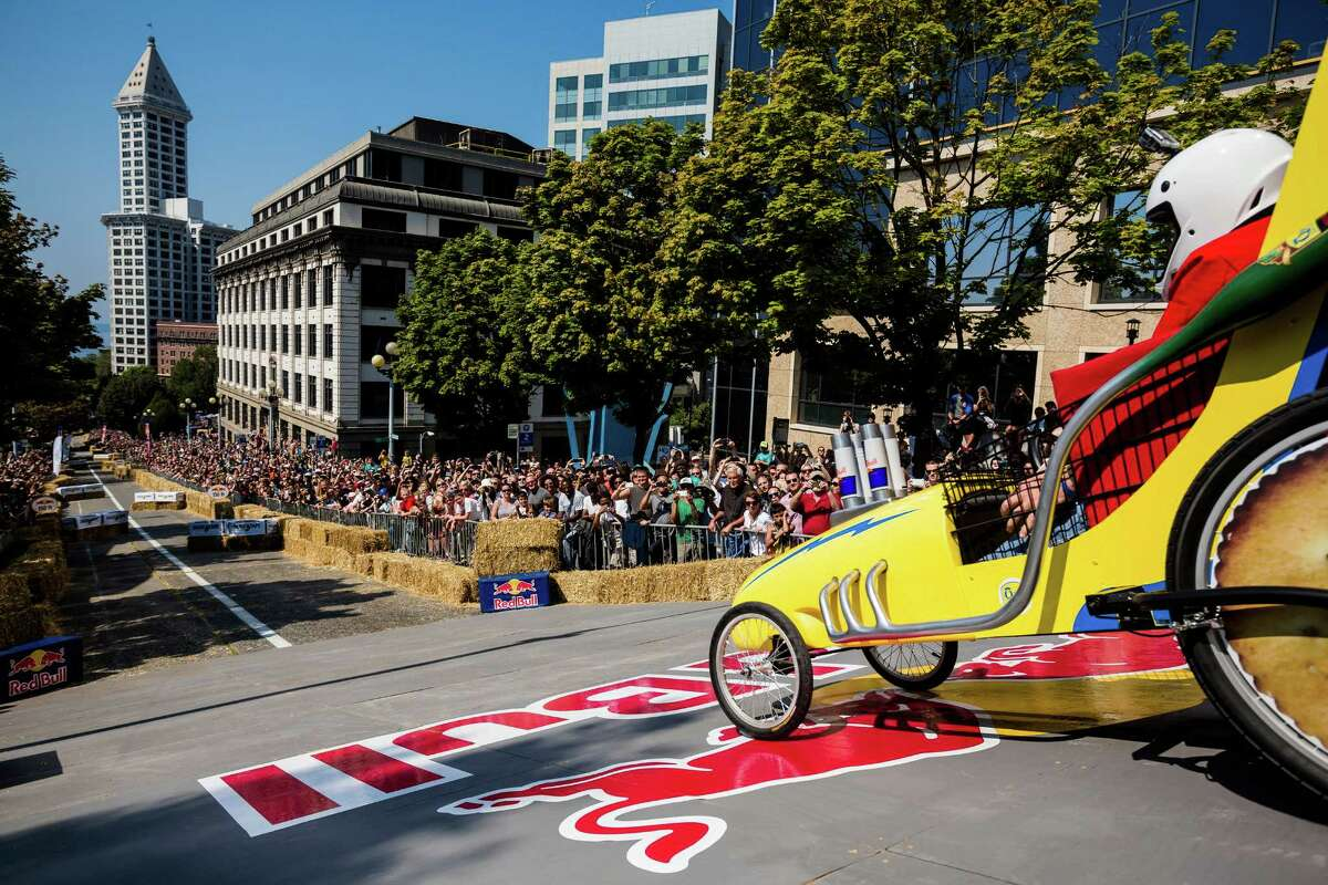 Team QFC begins their long descent down the steep grade of Yesler Way - with jumps and hard turns included - at the Red Bull Soapbox Race Sunday, August 24, 2014, in downtown Seattle, Washington. The rickety vehicles reached speeds of 40 miles per hour, sometimes plowing into the straw walls of the raceway. The first Red Bull Soapbox Race took place in Belgium in 2000, and has since visited almost 30 countries.