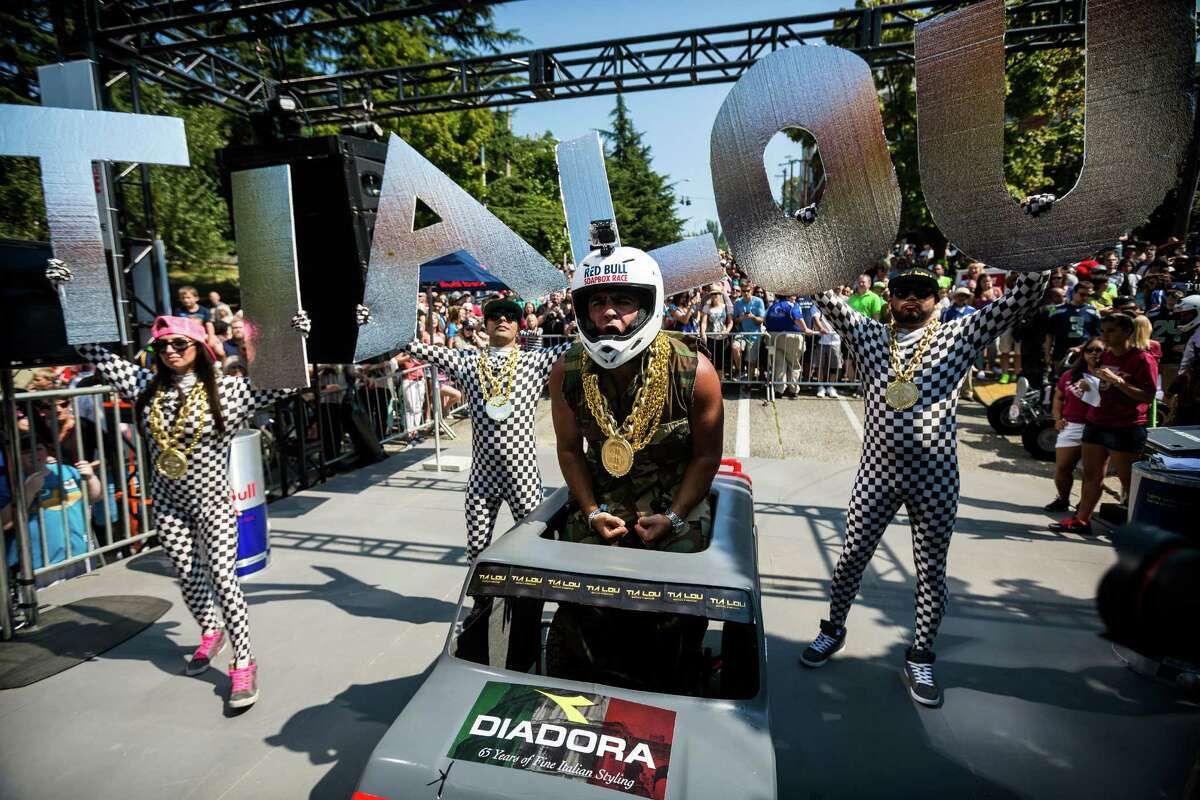 Team Tia Lou's gets hyped at the starting line before bombing down the steep grade of Yesler Way - with jumps and hard turns included - at the Red Bull Soapbox Race Sunday, August 24, 2014, in downtown Seattle, Washington. The rickety vehicles reached speeds of 40 miles per hour, sometimes plowing into the straw walls of the raceway. The first Red Bull Soapbox Race took place in Belgium in 2000, and has since visited almost 30 countries.