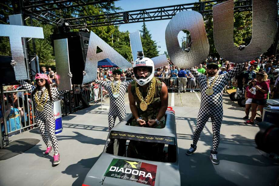 Team Tia Lou's gets hyped at the starting line before bombing down the steep grade of Yesler Way - with jumps and hard turns included - at the Red Bull Soapbox Race Sunday, August 24, 2014, in downtown Seattle, Washington. The rickety vehicles reached speeds of 40 miles per hour, sometimes plowing into the straw walls of the raceway. The first Red Bull Soapbox Race took place in Belgium in 2000, and has since visited almost 30 countries. Photo: JORDAN STEAD, SEATTLEPI.COM / SEATTLEPI.COM