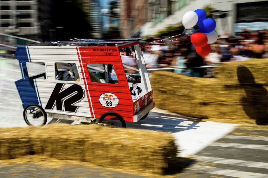 Team K2 rounds the curved turn near the finish line at the bottom of Yesler Way during the Red Bull Soapbox Race Sunday, August 24, 2014, in downtown Seattle, Washington. The rickety vehicles reached speeds of 40 miles per hour, sometimes plowing into the straw walls of the raceway. The first Red Bull Soapbox Race took place in Belgium in 2000, and has since visited almost 30 countries. Photo: JORDAN STEAD, SEATTLEPI.COM / SEATTLEPI.COM