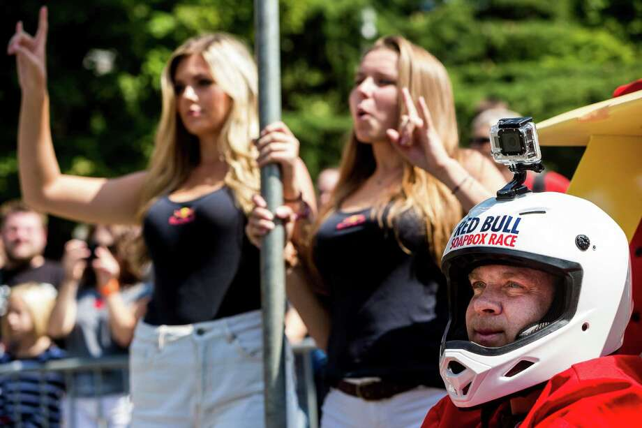 Teams wait at the starting line before bombing down the steep grade of Yesler Way - with jumps and hard turns included - at the Red Bull Soapbox Race Sunday, August 24, 2014, in downtown Seattle, Washington. The rickety vehicles reached speeds of 40 miles per hour, sometimes plowing into the straw walls of the raceway. The first Red Bull Soapbox Race took place in Belgium in 2000, and has since visited almost 30 countries. Photo: JORDAN STEAD, SEATTLEPI.COM / SEATTLEPI.COM