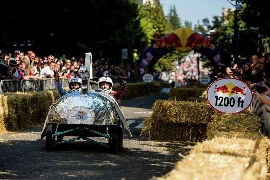 In front of tens of thousands of onlookers, over 30 costumed teams took to their man-made soapbox vehicles to self-power their way down the steep grade of Yesler Way - with jumps and hard turns included - at the Red Bull Soapbox Race Sunday, August 24, 2014, in downtown Seattle, Washington. The rickety vehicles reached speeds of 40 miles per hour, sometimes plowing into the straw walls of the raceway. The first Red Bull Soapbox Race took place in Belgium in 2000, and has since visited almost 30 countries. Photo: JORDAN STEAD, SEATTLEPI.COM / SEATTLEPI.COM