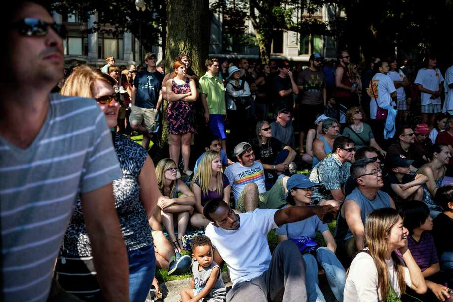 Tens of thousands of onlookers watch 30 costumed teams in their man-made soapbox vehicles bomb down the steep grade of Yesler Way - with jumps and hard turns included - at the Red Bull Soapbox Race Sunday, August 24, 2014, in downtown Seattle, Washington. The rickety vehicles reached speeds of 40 miles per hour, sometimes plowing into the straw walls of the raceway. The first Red Bull Soapbox Race took place in Belgium in 2000, and has since visited almost 30 countries. Photo: JORDAN STEAD, SEATTLEPI.COM / SEATTLEPI.COM