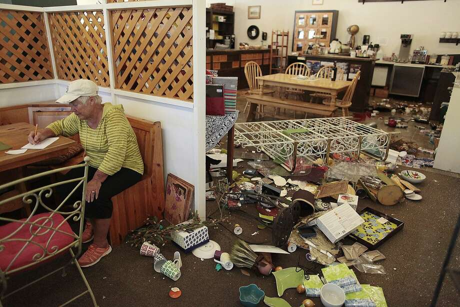Cheryl Richburg makes a to-do list for cleaning up her Napa Valley Traditions shop after the earthquake. Photo: James Tensuan, Special To The Chronicle