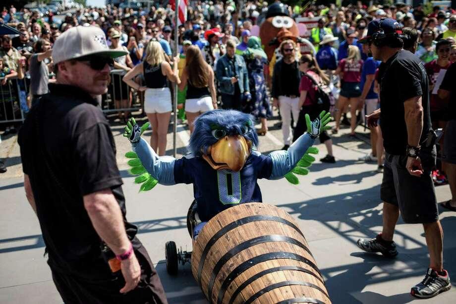 Seahawks mascot Blitz, center prepares to bomb down the steep grade of Yesler Way - with jumps and hard turns included - at the Red Bull Soapbox Race Sunday, August 24, 2014, in downtown Seattle, Washington. The rickety vehicles reached speeds of 40 miles per hour, sometimes plowing into the straw walls of the raceway. The first Red Bull Soapbox Race took place in Belgium in 2000, and has since visited almost 30 countries. Photo: JORDAN STEAD, SEATTLEPI.COM / SEATTLEPI.COM