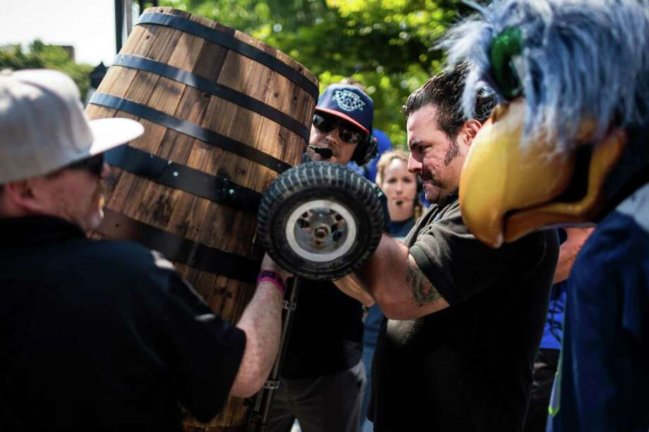 Red Bull technicians work to secure Blitz's soapbox before bombing down the steep grade of Yesler Way - with jumps and hard turns included - at the Red Bull Soapbox Race Sunday, August 24, 2014, in downtown Seattle, Washington. The rickety vehicles reached speeds of 40 miles per hour, sometimes plowing into the straw walls of the raceway. The first Red Bull Soapbox Race took place in Belgium in 2000, and has since visited almost 30 countries. Photo: JORDAN STEAD, SEATTLEPI.COM / SEATTLEPI.COM