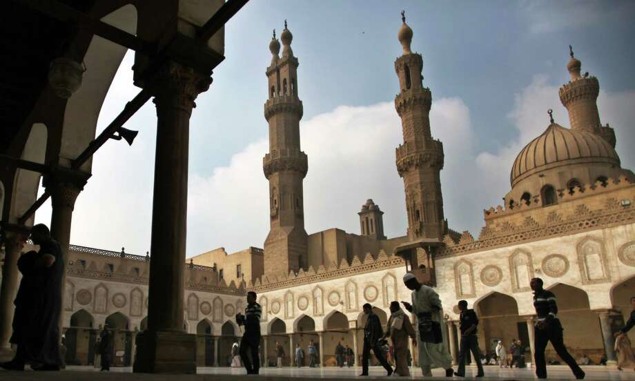 "FILE - In this Friday, Dec. 28, 2012 file photo, Muslims arrive to attend the Friday prayer at Al-Azhar mosque in Cairo, Egypt. Dar el-Ifta, the top Islamic authority in Egypt, revered by many Muslims worldwide, launched Sunday an internet-based campaign aimed particularly at the West against an extremist group in Syria and Iraq, saying it is not an ""Islamic State."" The Grand Mufti of Egypt, Shawki Allam, and clerics from the oldest Islamic learning institute, Al-Azhar, have condemned the Islamic State saying it was violating all Islamic principles and laws, describing it as a danger to the religion. (AP Photo/Khalil Hamra, File) Photo: Khalil Hamra, STF / AP"