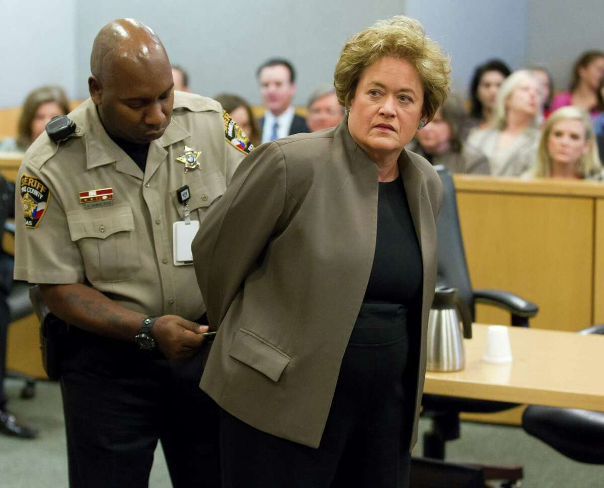 USE THIS PHOTO 3 COLUMNS PLEASE -- Travis County District Attorney Rosemary Lehmberg is handcuffed after pleading guilty to drunken driving on Friday, April 19, 2013.RICARDO B. BRAZZIELL / AMERICAN- STATESMAN