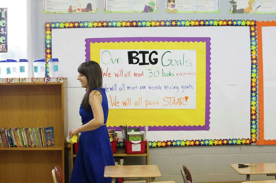 Emily Cracolici, a first-year teacher at Fondren Middle School, was able to raise more than $500 through two crowdfunding campaigns online to help build a classroom library. Photo: Johnny Hanson, Staff / © 2014  Houston Chronicle