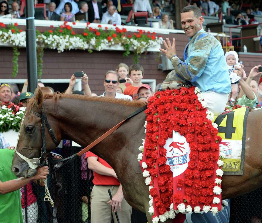 V.E. Day with a very happy jockey Javier Castellano stands with the connections in the winner's circle Saturday afternoon Aug. 23, 2014, after winning the 145th running of the Travers at the Saratoga Race Course in Saratoga Springs, N.Y.       (Skip Dickstein/Times Union) Photo: SKIP DICKSTEIN