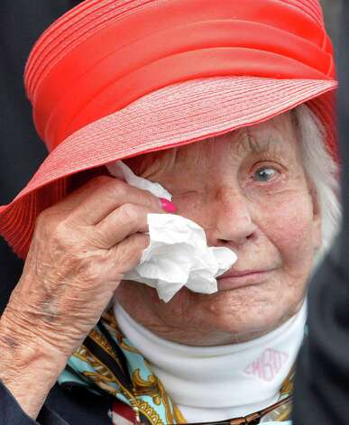 V.E. Day's owner Magalen O. Bryant wipes tears from her eyes Saturday afternoon Aug. 23, 2014,  after her horse won the 145th running of the Travers at the Saratoga Race Course in Saratoga Springs, N.Y.       (Skip Dickstein/Times Union) Photo: SKIP DICKSTEIN