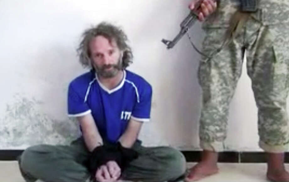 In this image made from undated video obtained by The Associated Press, which has been authenticated based on its contents and other AP reporting, a man believed to be Peter Theo Curtis, a U.S. citizen held hostage by an al-Qaida linked group in Syria, delivers a statement. The U.S. government said on Sunday, Aug. 24, 2014 that Curtis, who had been held hostage for about two years, had been released. (AP Photo) Photo: HOEP / AP