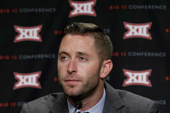 Texas Tech head coach Kliff Kingsbury listens to a reporters' question during the NCAA college Big 12 Conference Football Media Days in  Dallas, Monday, July 21, 2014. (AP Photo/LM Otero)