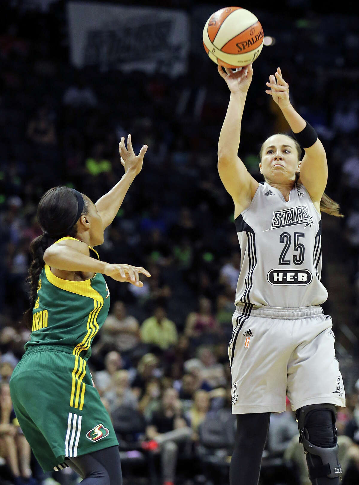 San Antonio Stars' Becky Hammon shoots around Seattle Storm's Temeka Johnson during first half action Friday July 11, 2014 at the AT&T Center.