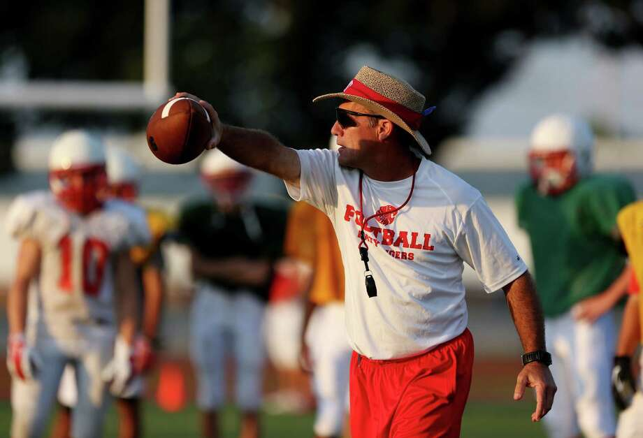 When Gary Joseph, a soft-spoken man away from football, speaks on the practice field, every one of his Katy Tigers listens. Photo: Gary Coronado, Staff / © 2014 Houston Chronicle