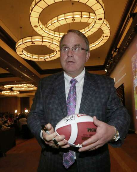 TCU head coach Gary Patterson finishes up signing a football during the NCAA college Big 12 Conference football media days in Dallas, Monday, July 21, 2014. (AP Photo/LM Otero) Photo: LM Otero, STF / AP