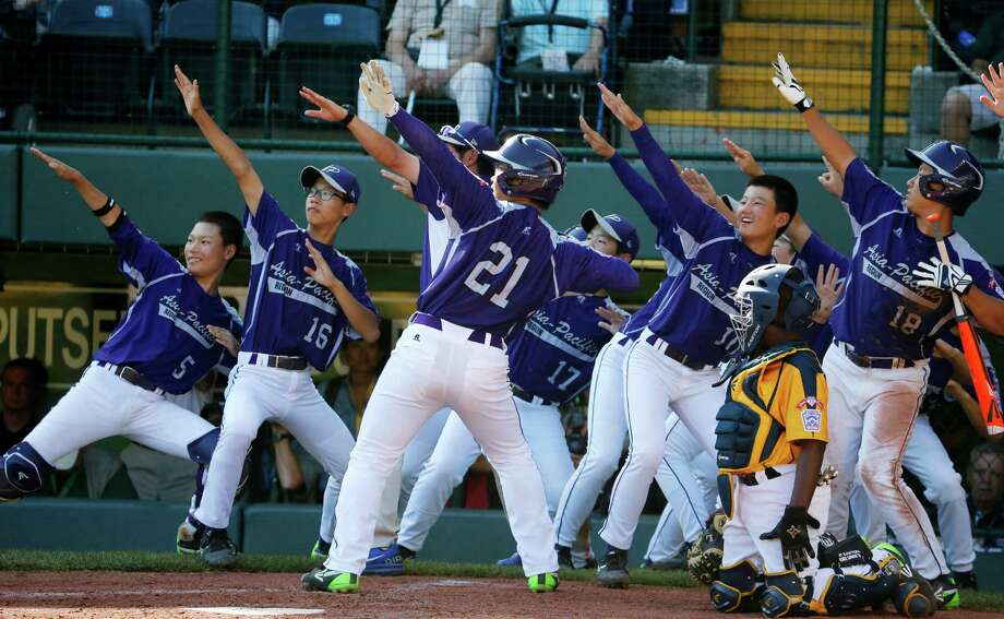 South Korea's Hae Chan Choi (21) celebrates with teammates after hitting a two-run home run off  Chicago's Brandon Green in the sixth inning of the Little League World Series championship baseball game in South Williamsport, Pa., Sunday, Aug. 24, 2014. (AP Photo/Gene J. Puskar) Photo: Gene J. Puskar, STF / AP