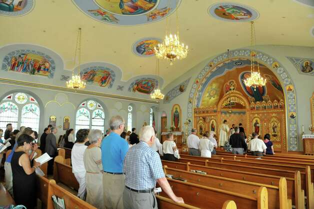 Parishioners stand for prayers during a Ukrainian Independence Day memorial service at Saint Nicholas Ukrainian Catholic Church on Sunday, Aug. 24, 2014, in Watervliet, N.Y. The service was held to honor the Ukrainian soldiers who have died and the victims of Flight MH 17, which was shot down over Ukraine.  The service was attended by parishioners from area Ukrainian churches and members of the Armenian community.  (Paul Buckowski / Times Union) Photo: Paul Buckowski / 00028160A