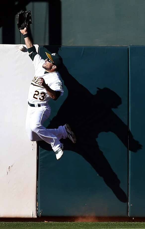 Sam Fuld leaps in an attempt to grab Erick Aybar's double. Photo: Tony Avelar, Associated Press
