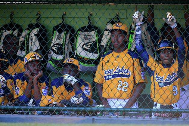 SOUTH WILLIAMSPORT, PA - AUGUST 24: Members of the Great Lakes Team from Chicago, Illinois look on from the dugout during the sixth inning of their 8-4 loss to Team Asia-Pacific during the Little League World Series Championship game at Lamade Stadium on August 24, 2014 in South Williamsport, Pennsylvania.  (Photo by Rob Carr/Getty Images) ORG XMIT: 508283193 Photo: Rob Carr / 2014 Getty Images