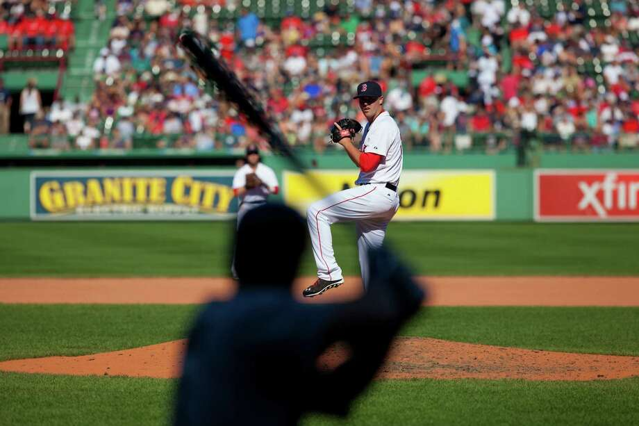 BOSTON, MA - AUGUST 24: Heath Hembree #37 of the Boston Red Sox pitches against the Seattle Mariners during the sixth inning at Fenway Park on August 24, 2014 in Boston, Massachusetts. (Photo by Rich Gagnon/Getty Images) ORG XMIT: 477588601 Photo: Rich Gagnon / 2014 Getty Images