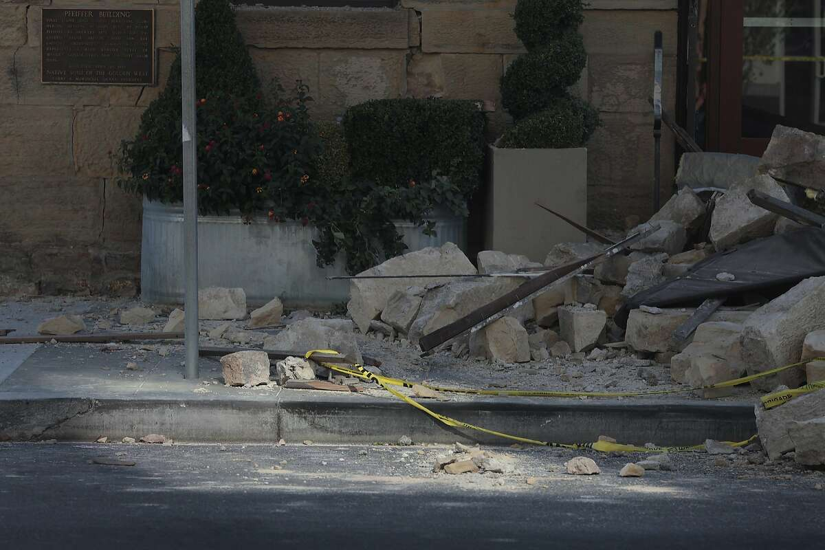 Rubble from a building is seen on Main St. on Sunday, August 24, 2014 in Napa, Calif. A 6.0 earthquake rattled much of the Bay Area early Sunday morning.