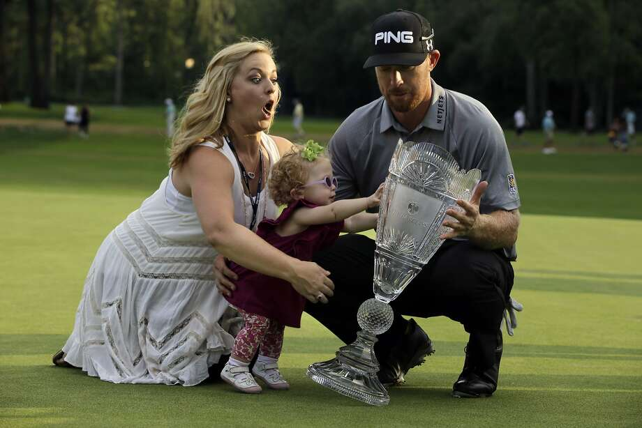 Why trophies should not be made of glass: Kandi Mahan tries to grab baby Zoe as she nearly topples dad Hunter's championship trophy after The Barclays golf tournament in Paramus, N.J.  Photo: Mel Evans, Associated Press